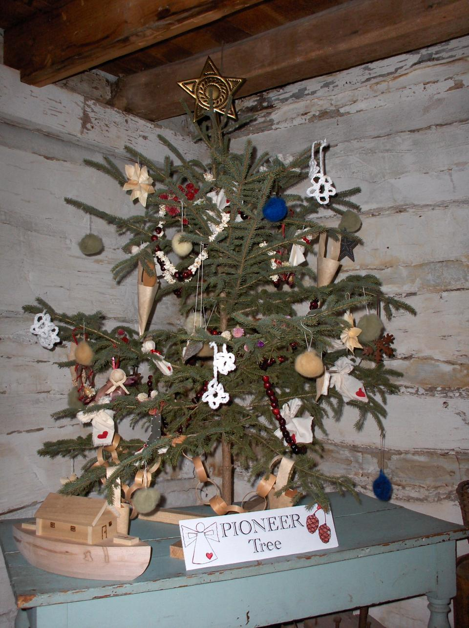 Small tree decorated with simple homemade decorations in the pioneer cabin