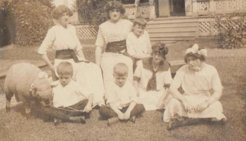 photo of young women on lawn with a lamb won at a fair