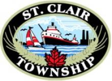 Logo of St. Clair Township featuring a Great Lakes freighter