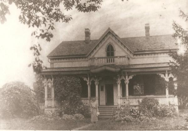 photo of large gracious home, with Hortense Reilley in front